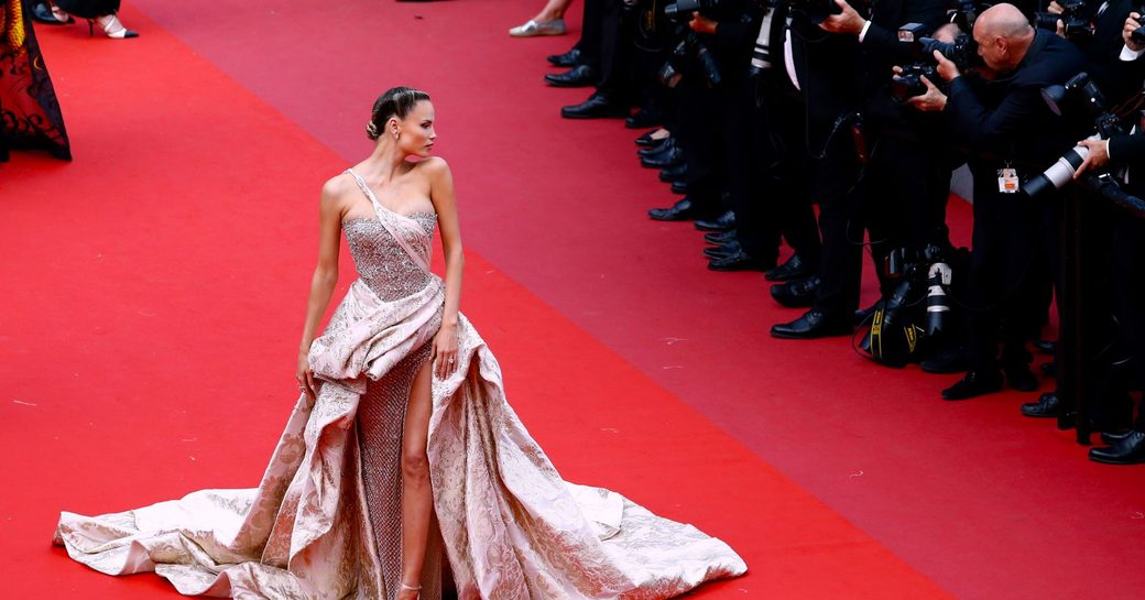 natasha poly attendes cannes film festival on red carpet