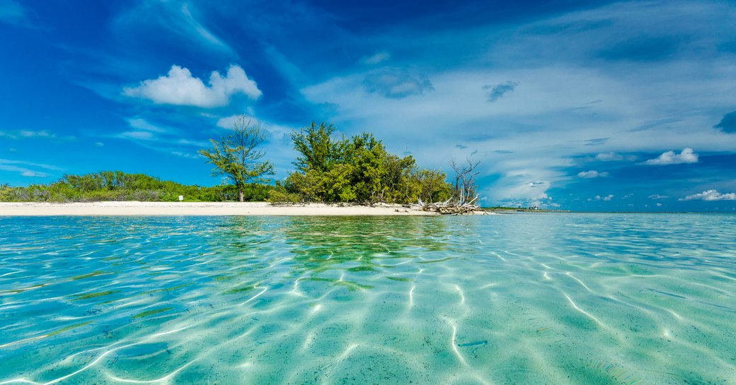 Crystal-clear water near remote island in the Bahamas