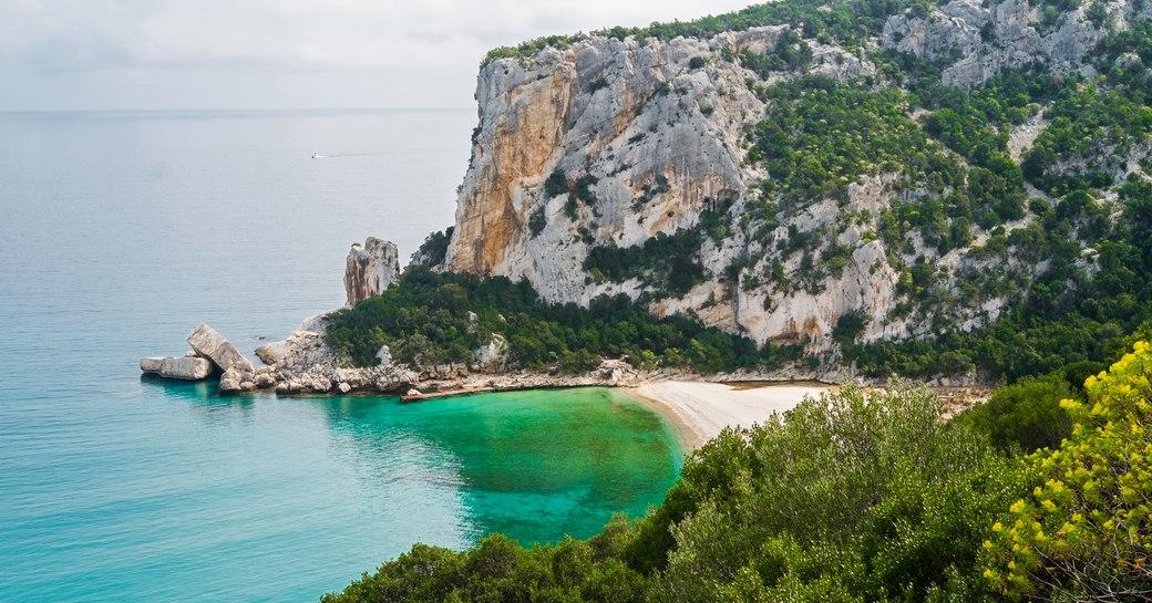 Crescent shaped sandy beach in Sardinia