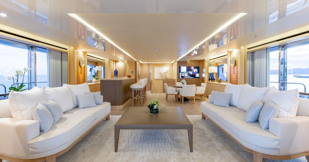 white sofas form a sociable seating area on board a superyacht