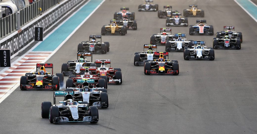 Front view of cars racing on the track of Yas Marina Circuit at the Abu Dhabi Grand Prix, beginning to turn a corner