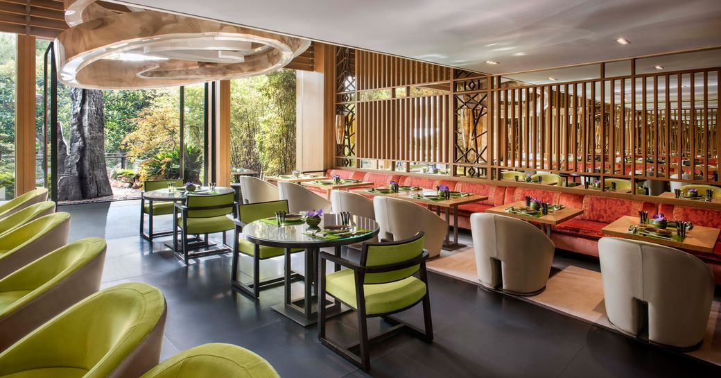 dining room of Yoshi Japanese restaurant in Monaco, with green accents and views over green space