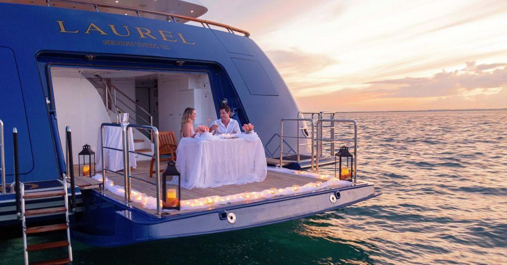 romantic meal on swim platform of superyacht