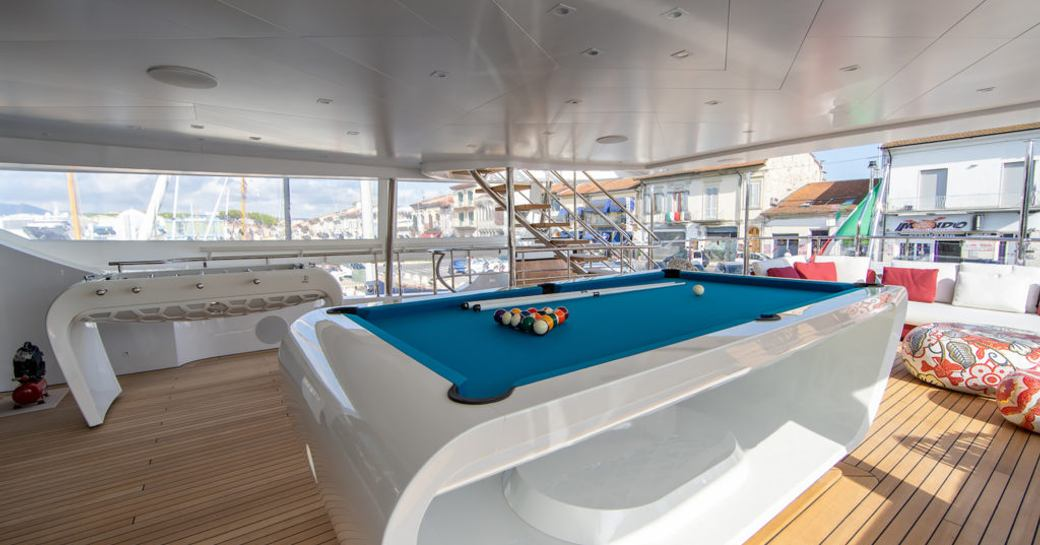 games tables on the decks of benetti luxury yacht happy me