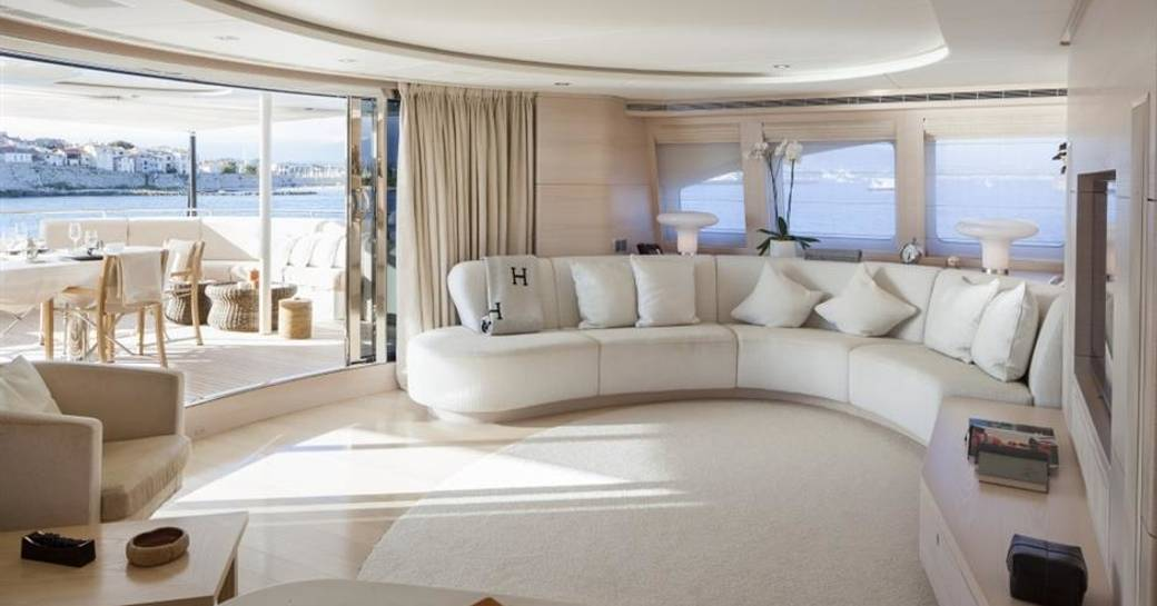 multifunctional skylounge with curved sofa aboard charter yacht G3