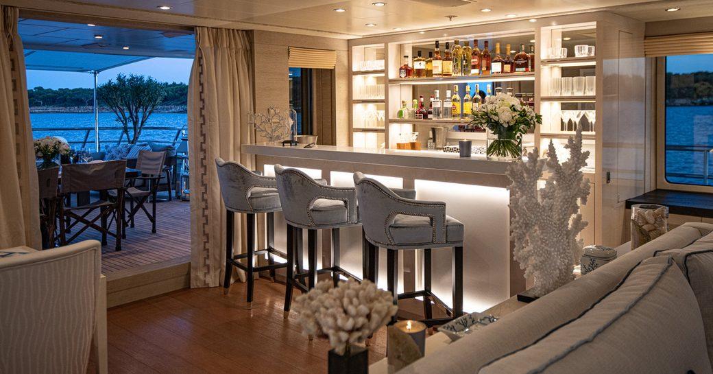 luxury yacht spirit backlit bar in the main salon