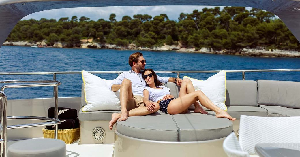 a couple enjoying some quality time together while on their luxury yacht charter in the caribbean for some well deserved rest and relaxation in a stress and risk free zone