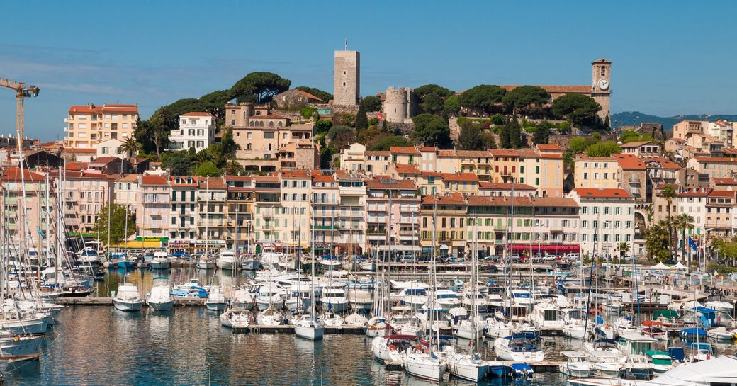 the busy port of Cannes lined with charming buildings along the French Riviera