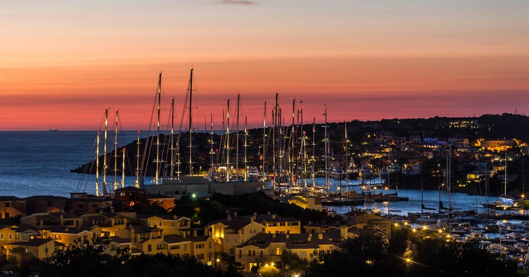 yachts gather in Porto Cervo marina as the sun sets during the Perini Navi Cup