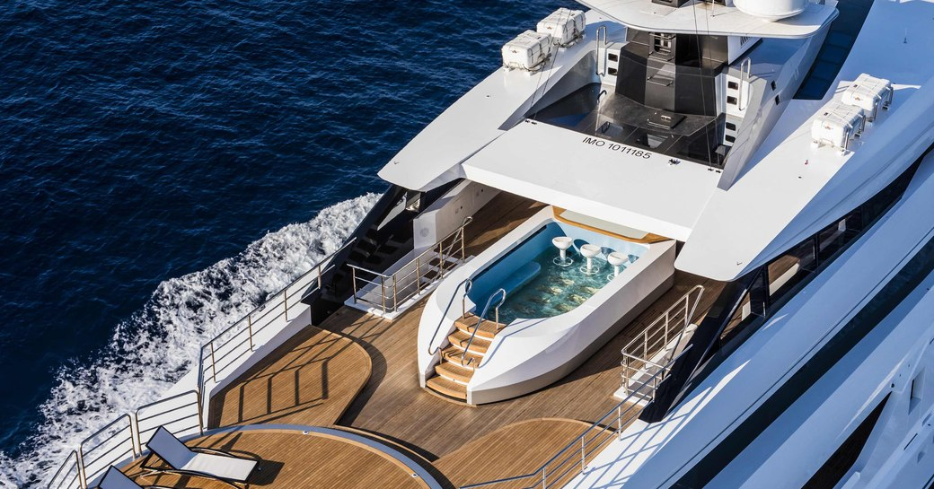 aerial view of luxury yacht suerte's sundeck swimming pool