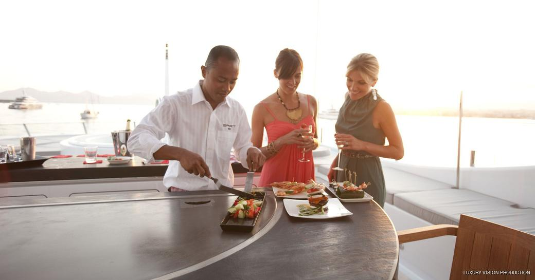 teppanyaki grill on charter yacht, showing charter guests how to make food