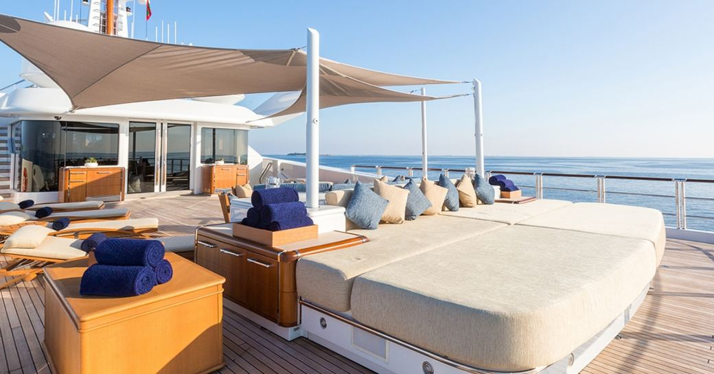 sunpads and seating on the sundeck of superyacht WHEELS