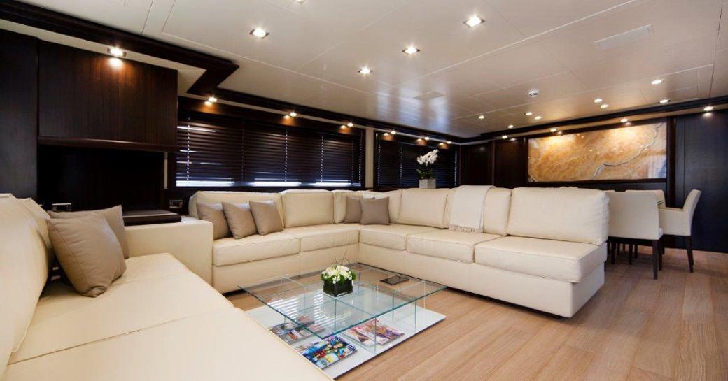 Superyacht GATSBY interiors - showing cream sofas and decked floor
