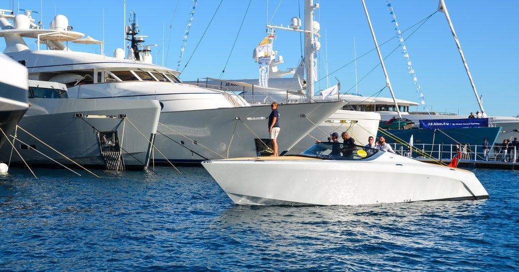 monaco yacht show tender lined up alongside luxury megayacht
