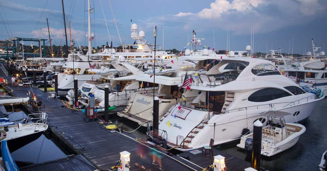 luxury yachts lined up for Newport Charter Yacht Show