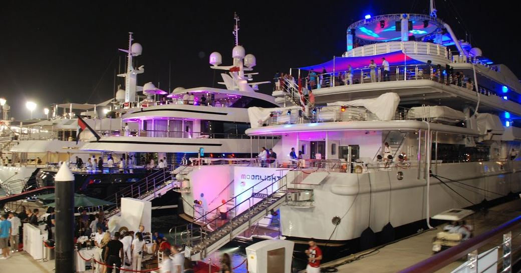 Image of people getting on board superyachts berthed in Yas Marina