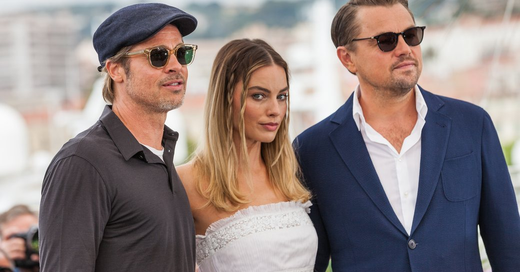 margot robbie, brad pitt and leonardo dicaprio in front of yachts in the marina at cannes