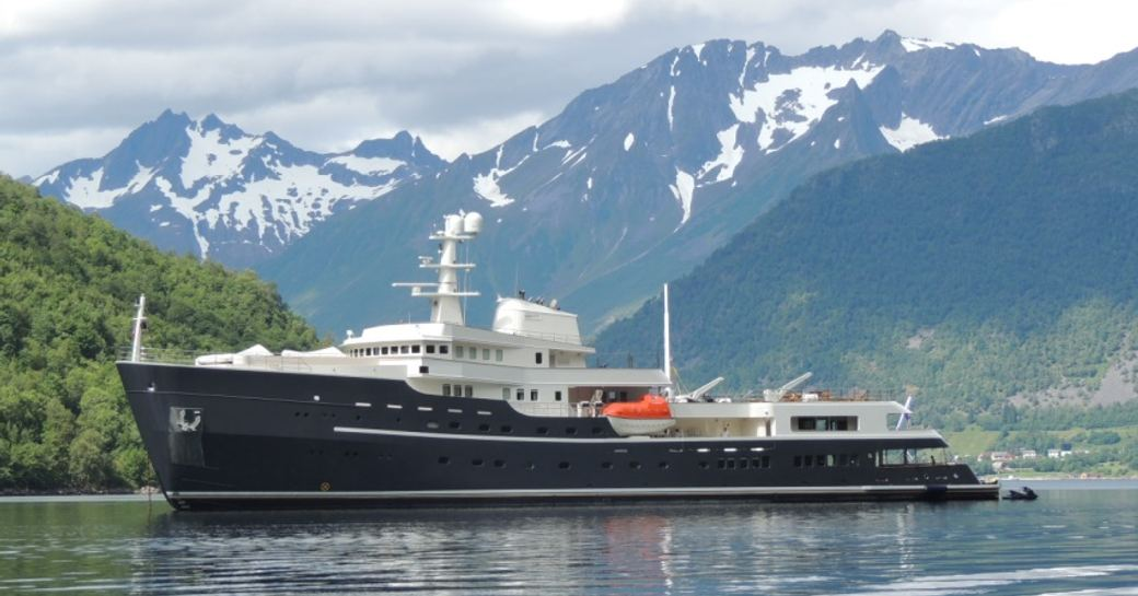 The iconic superyacht LEGEND with snowy mountains in the background