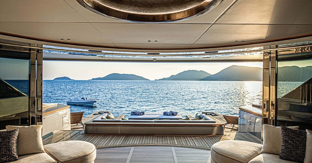 main salon and wide open glass doors on board benetti superyacht rebeca