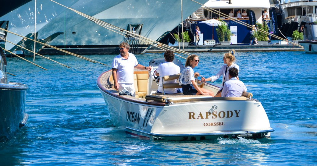 tender with show attendees cruising at monaco yacht show