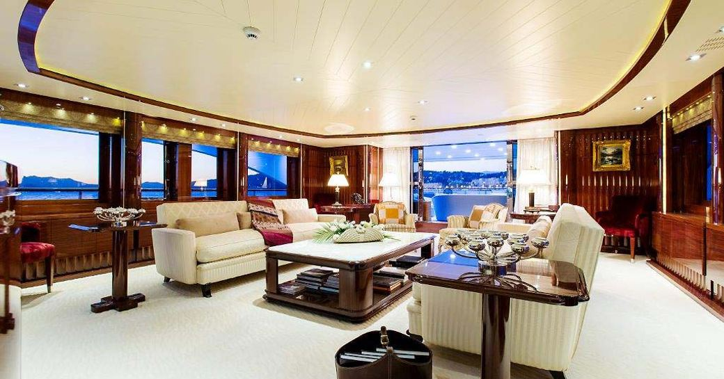 VERTIGO superyacht  main salon, with cream sofas and cream carpet