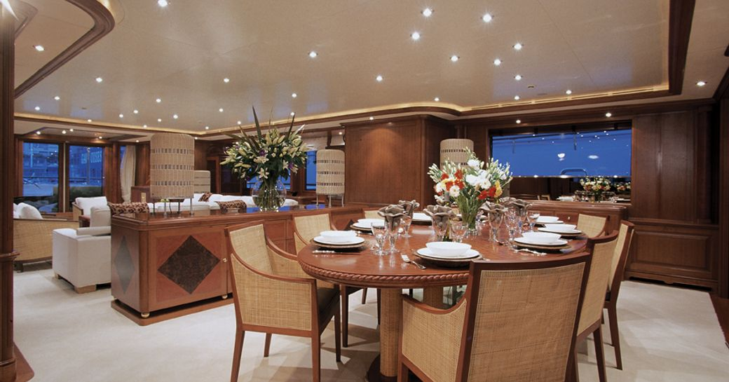 formal dining area in main salon of charter yacht JO