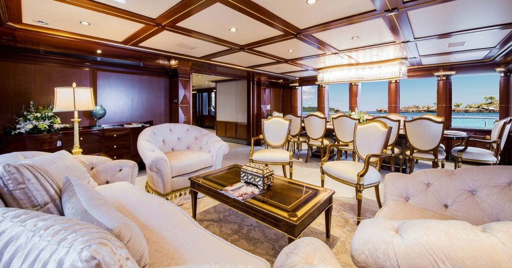 opulent main salon with fittings brushed in gold on board motor yacht My Seanna