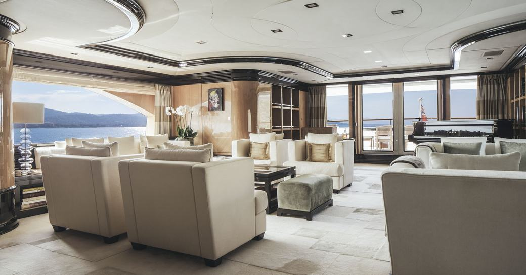 light and airy master suite with two lounge areas aboard superyacht MEAMINA