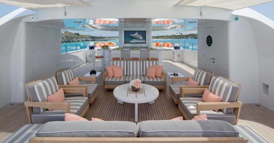 the luxurious sundeck of charter yacht time for us in the bahamas