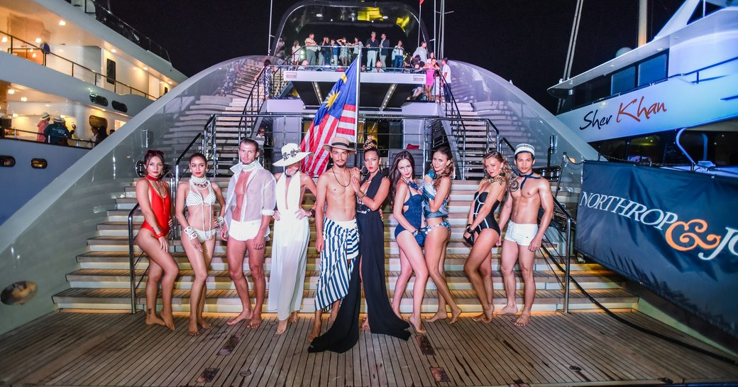 models line up on swim platform of superyacht Ocean Emerald for a glitzy fashion show at the Thailand Yacht Show 2016