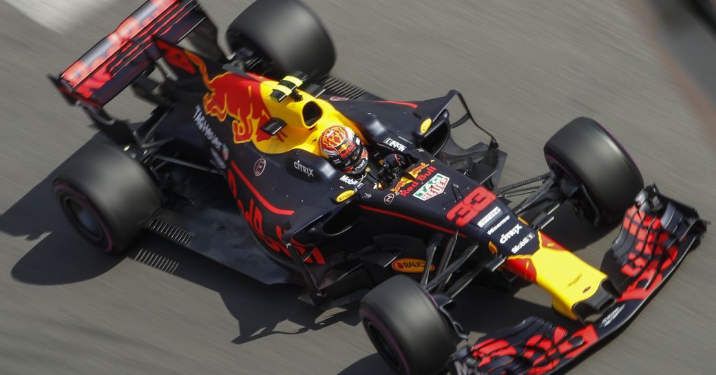 motor car whizzes around the track at the monaco grand prix