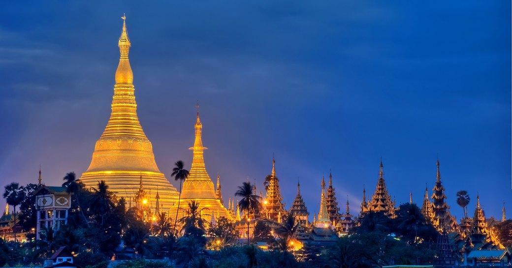 view of myanmar skyline of pagoda's at night