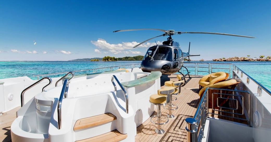 Helicopter on sundeck of superyacht on my seanna