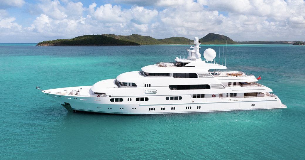 superyacht titania at anchor in the Bahamas where her charter guests are enjoying a self isolating yacht charter vacation during this covid-19 pandemic
