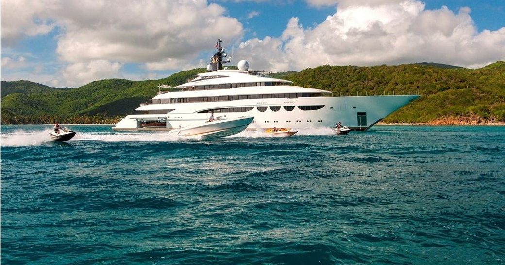 superyacht QUATTROELLE alongside tenders and water toys