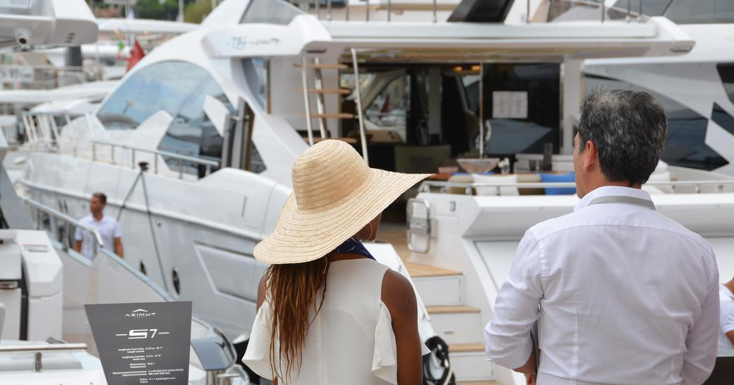 Woman stands with yacht broker at Cannes Yachting Festival