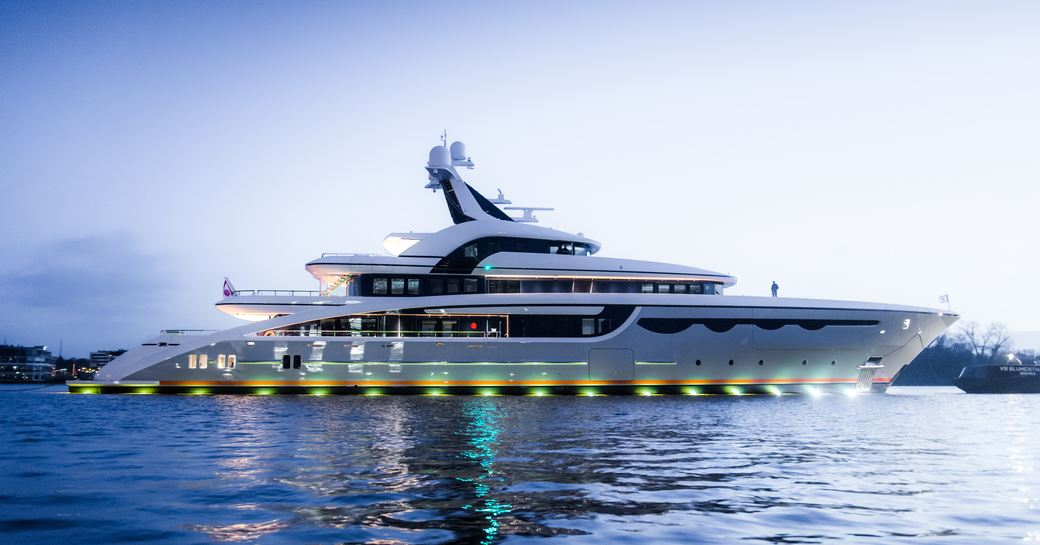 the beam of superyacht soaring by Abeking & Rasmussen underway in the Caribbean