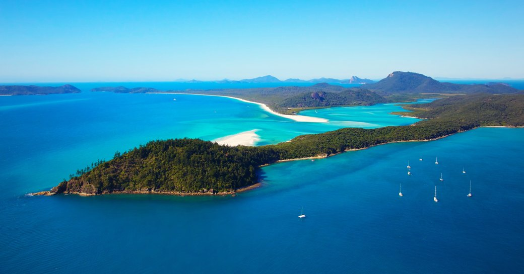 Luxury yachts at anchor in the Whitsunday Islands, Australia