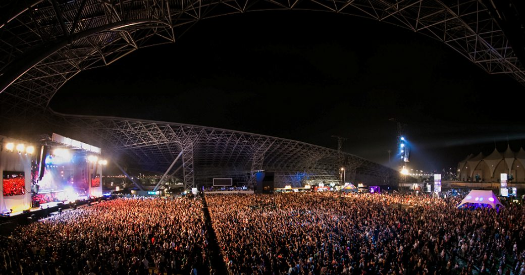 Aerial shot of crowds of people watching a concert at the F1 after-race entertainment at Du Arena, Abu Dhabi