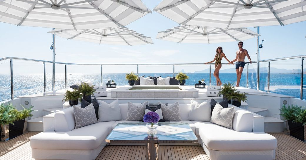 seating area, pool and sun pads on the sundeck of motor yacht 11/11