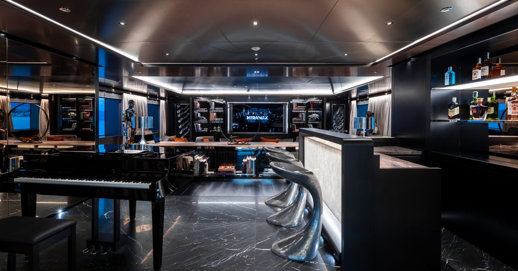 bar area and piano on board motor yacht solo