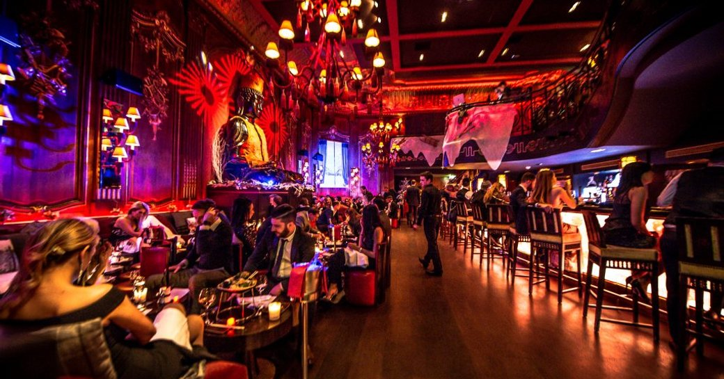diners enjoying drinks at buddha bar in monaco, centre of monte carlo