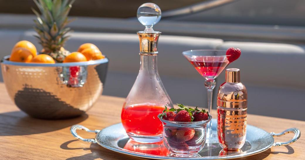 Bespoke cocktail set on silver tray with berries and fruit on Luxury charter yacht ANAMEL