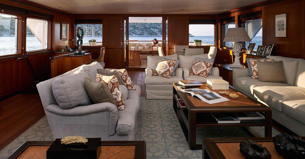 classically-styled main salon aboard luxury yacht ANCALLIA