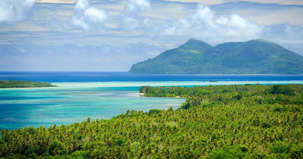 view of lush jungle and blue seas from sky deck in Vanuatu