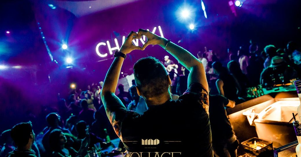 DJ making love heart with hands at crowds attending the after-race entertainment at Abu Dhabi Grand Prix F1