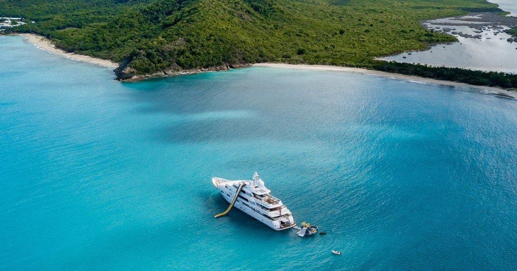 Aerial shot of luxury yacht TITANIA from Lurssen in the waters surrounding the Maldives