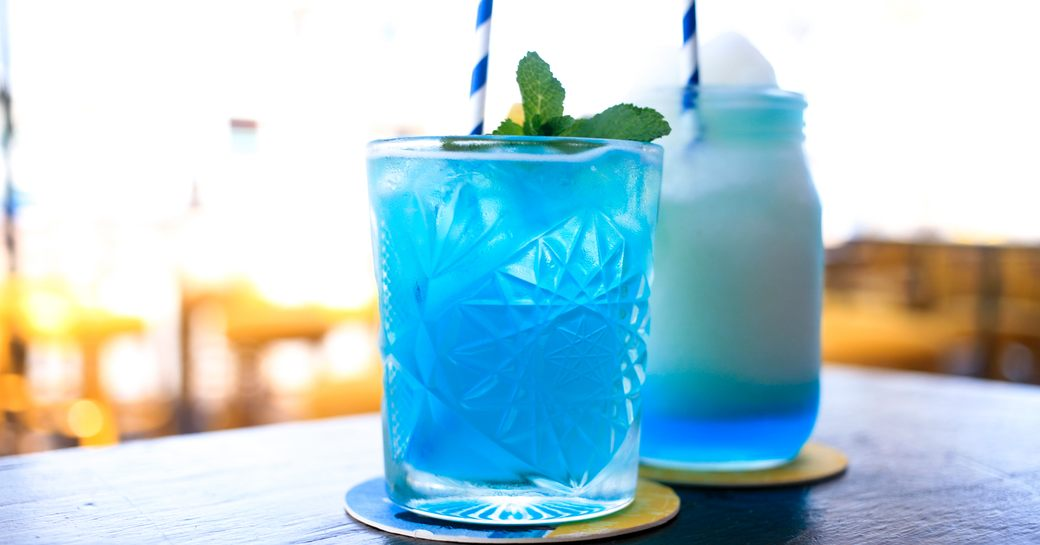heavenly blue hued cocktail with fluffy cream on the table of a yacht club in St. Lucia