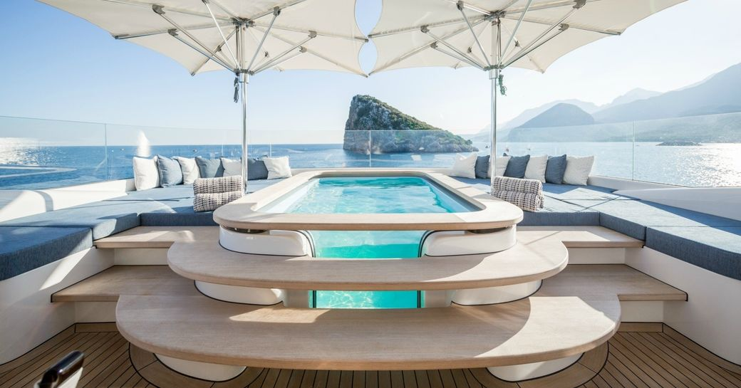Jacuzzi and awnings on sundeck of luxury yacht RUYA