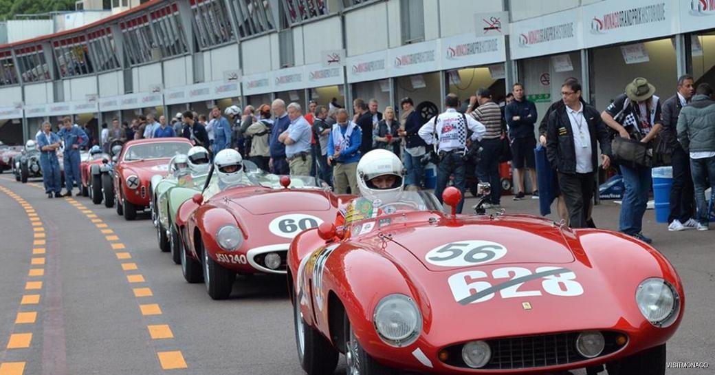 Lineup of historic Grand Prix cars at Monaco Historic Grand Prix along pit lane.